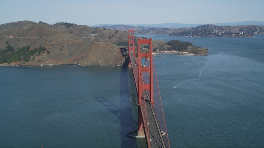 5K stock footage aerial video of flying by the Golden Gate Bridge with light traffic, San Francisco, California Aerial Stock Footage | DFKSF15_033
