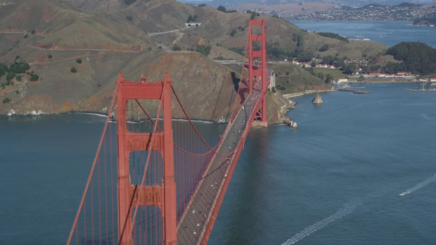 5K stock footage aerial video of flying by the Golden Gate Bridge with light traffic, San Francisco, California Aerial Stock Footage | DFKSF15_034