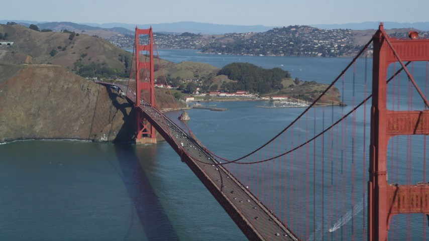5K stock footage aerial video of passing by the Golden Gate Bridge with light traffic, San Francisco, California Aerial Stock Footage | DFKSF15_035