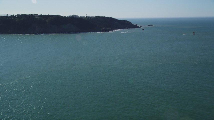 5K stock footage aerial video of tilting from San Francisco Bay to reveal coastal cliffs, San Francisco, California Aerial Stock Footage | DFKSF15_037