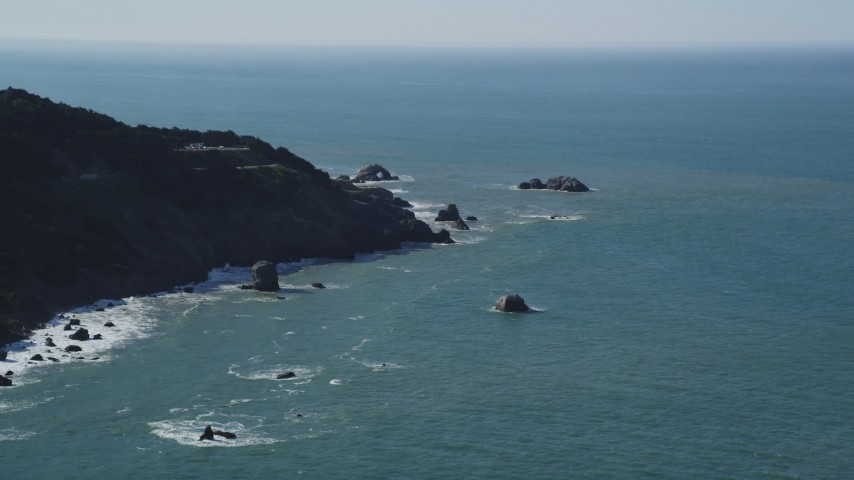 5K stock footage aerial video of flying by coastal cliffs while approaching Seal Rocks, San Francisco, California Aerial Stock Footage | DFKSF15_038