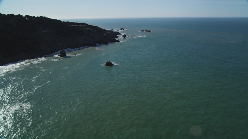 5K stock footage aerial video of tilting from San Francisco Bay, reveal Seal Rocks rock formations, San Francisco, California Aerial Stock Footage | DFKSF15_039