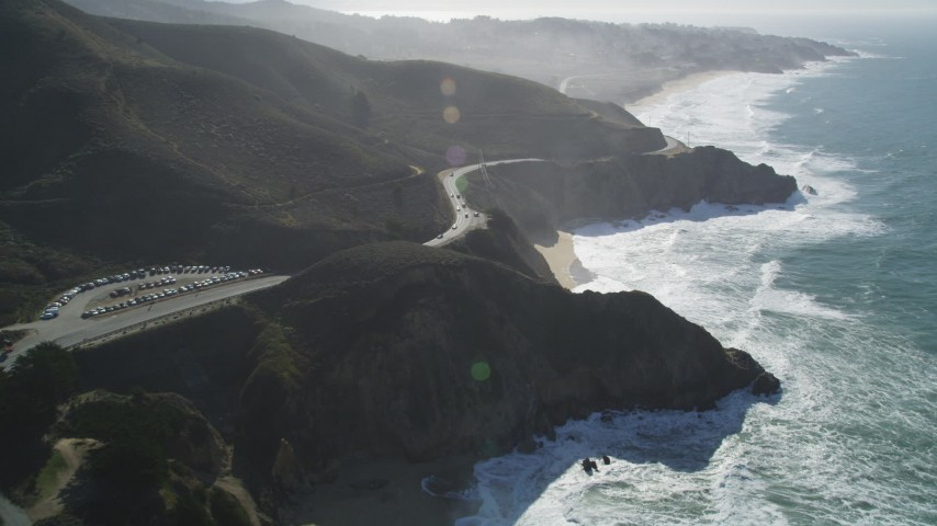 5K aerial stock footage video of following Highway 1 along the coast, winding above cliffs, Montara, California Aerial Stock Footage | DFKSF15_060