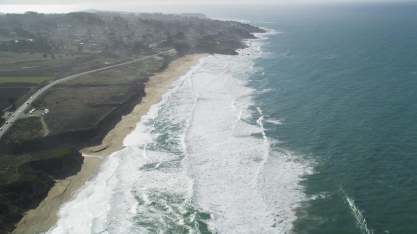 5K stock footage aerial video of flying over Montara State Beach, tilt revealing coastal neighborhoods, Montara, California Aerial Stock Footage | DFKSF15_062