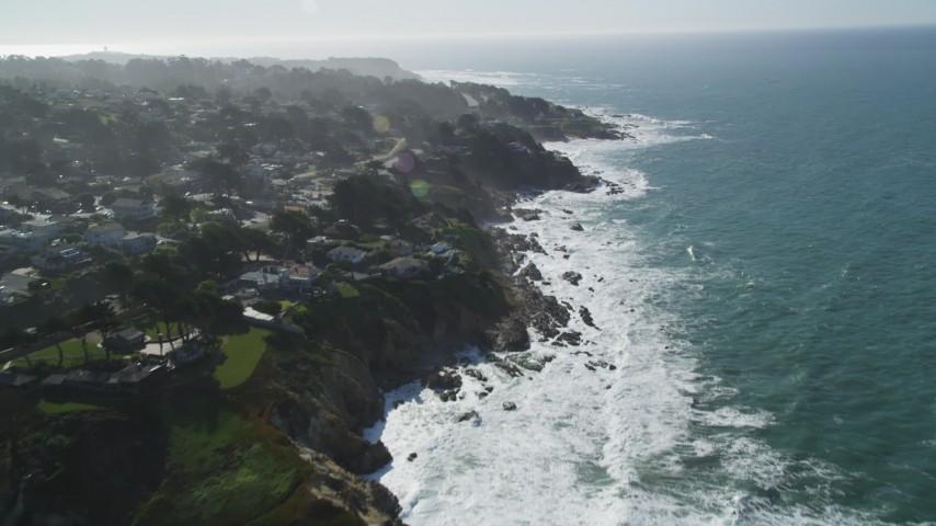 5K stock footage aerial video of tilting from Montara State Beach, revealing coastal neighborhoods, Montara, California Aerial Stock Footage | DFKSF15_063