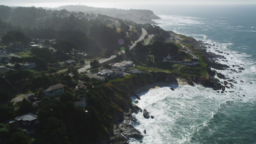 5K stock footage aerial video of flying by coastal neighborhoods and tilting to lighthouse, Montara, California Aerial Stock Footage | DFKSF15_064