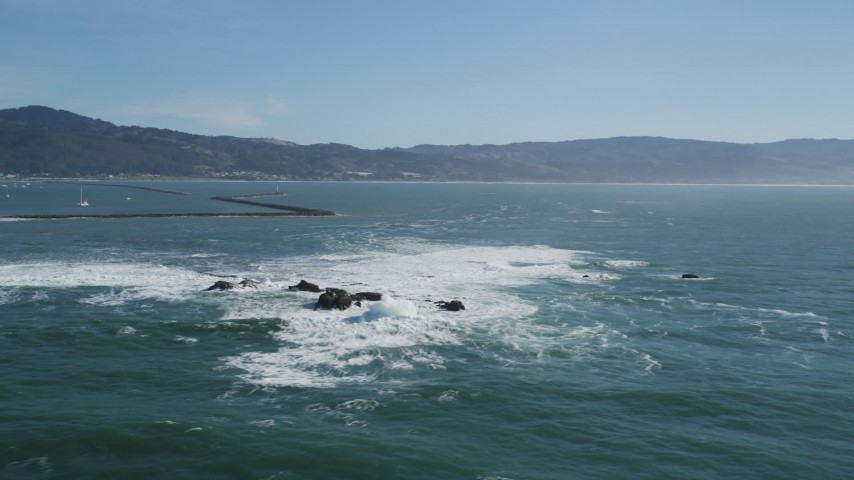 5K stock footage aerial video of flying by rock formations near a harbor in Half Moon Bay, California Aerial Stock Footage | DFKSF15_069