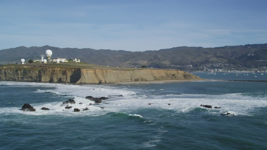 5K stock footage aerial video orbit rock formations, reveal Pillar Point Air Force Station, Half Moon Bay, California Aerial Stock Footage | DFKSF15_070