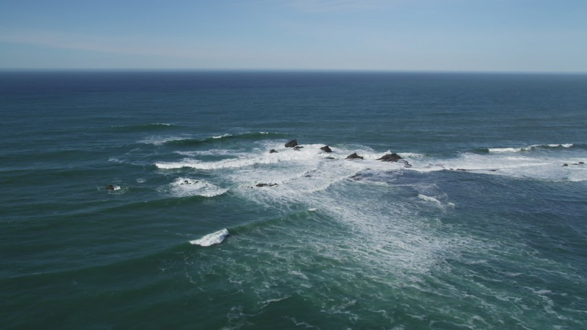 5K stock footage aerial video of flying by waves crashing into rock formations, Half Moon Bay, California Aerial Stock Footage | DFKSF15_071