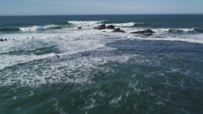 5K stock footage aerial video tilt to reveal rock formations and fly out over ocean, Half Moon Bay, California Aerial Stock Footage | DFKSF15_073