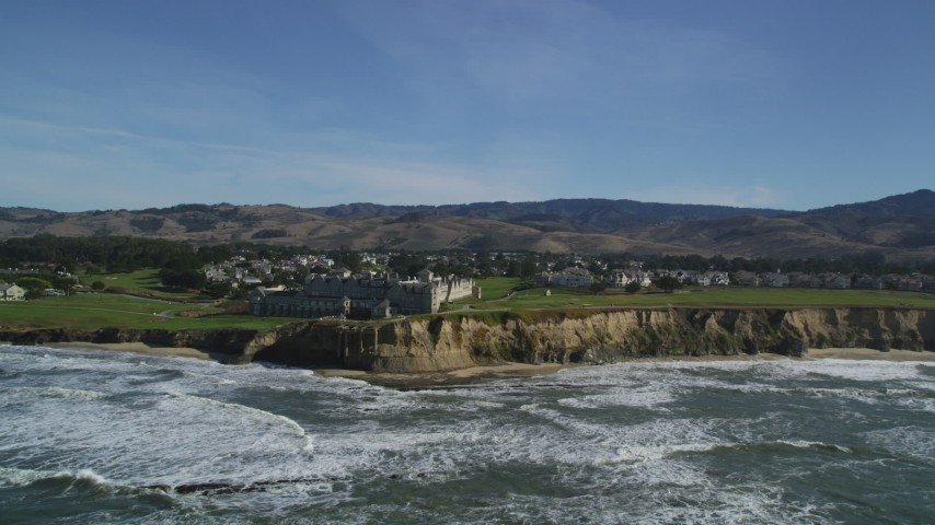 5K stock footage aerial video of a reverse view of The Ritz Carlton hotel on coastal cliffs, Half Moon Bay, California Aerial Stock Footage DFKSF15_077 | Axiom Images