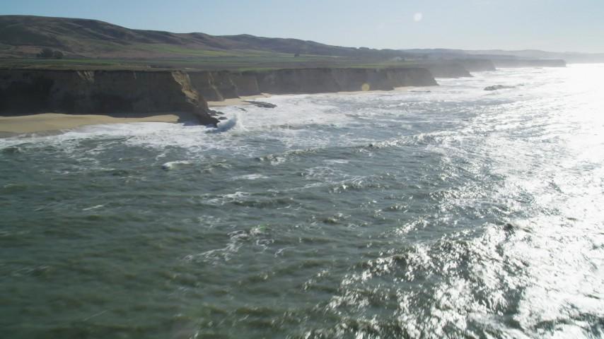 5K stock footage aerial video of flying by coastal cliffs, Half Moon Bay, California Aerial Stock Footage | DFKSF15_078
