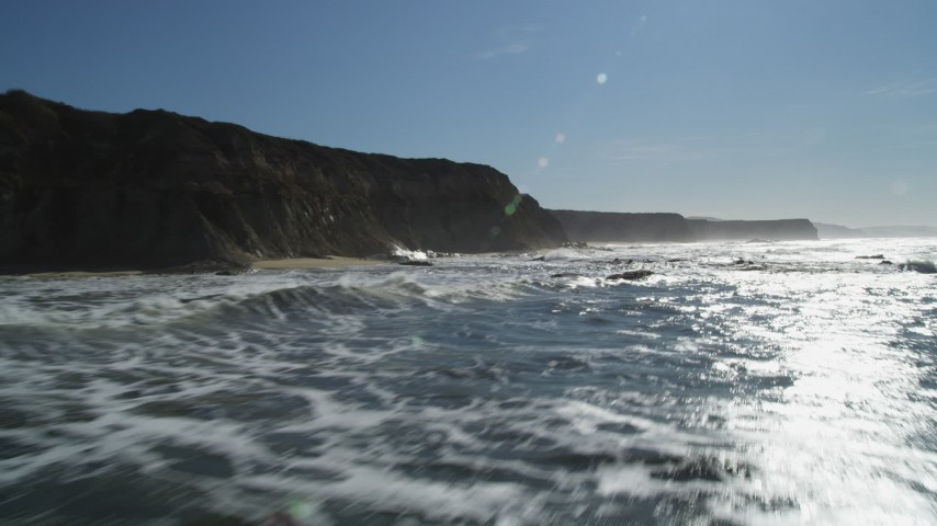 5K stock footage aerial video of flying low over the ocean near cliffs, Half Moon Bay, California Aerial Stock Footage | DFKSF15_081
