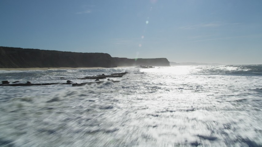 5K stock footage aerial video of flying low near cliffs and ocean rock formations, Half Moon Bay, California Aerial Stock Footage | DFKSF15_082