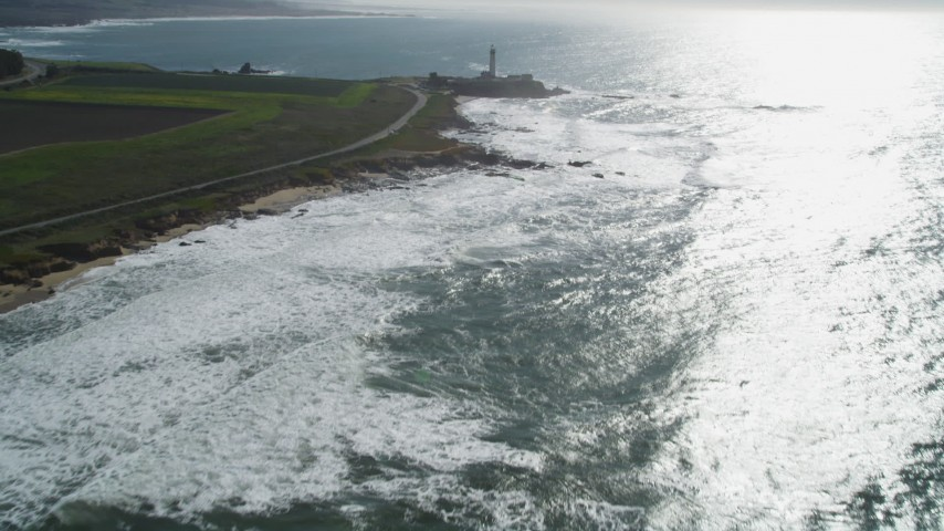 5K stock footage aerial video of tilting from the ocean to reveal Pigeon Point Light Station, Pescadero, California Aerial Stock Footage | DFKSF15_095