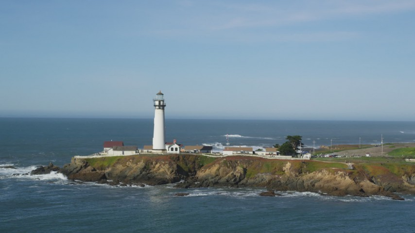5K stock footage aerial video of flying away from Pigeon Point Light Station in Pescadero, California Aerial Stock Footage | DFKSF15_098