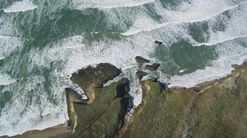 5K stock footage aerial video of a reverse view of ocean waves, revealing the coast, Pescadero, California Aerial Stock Footage | DFKSF15_101