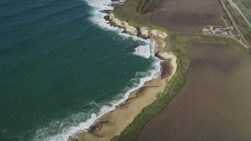 5K stock footage aerial video of a reverse view of coastal beaches, Davenport, California Aerial Stock Footage | DFKSF15_116