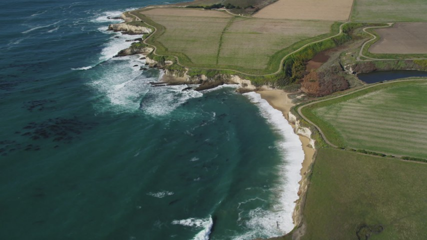 5K stock footage aerial video of flying away from coastal cliffs, Santa Cruz, California Aerial Stock Footage | DFKSF15_118