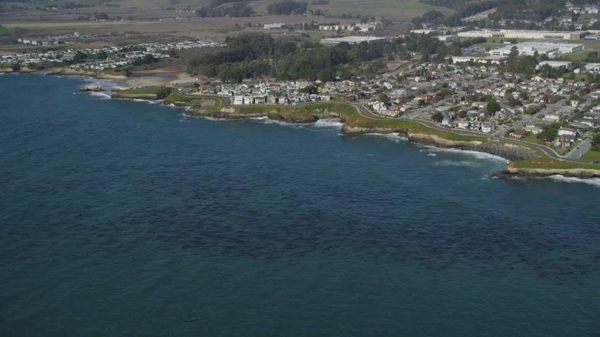 5K stock footage aerial video of passing by kelp forests and coastal neighborhoods, Santa Cruz, California Aerial Stock Footage | DFKSF15_120