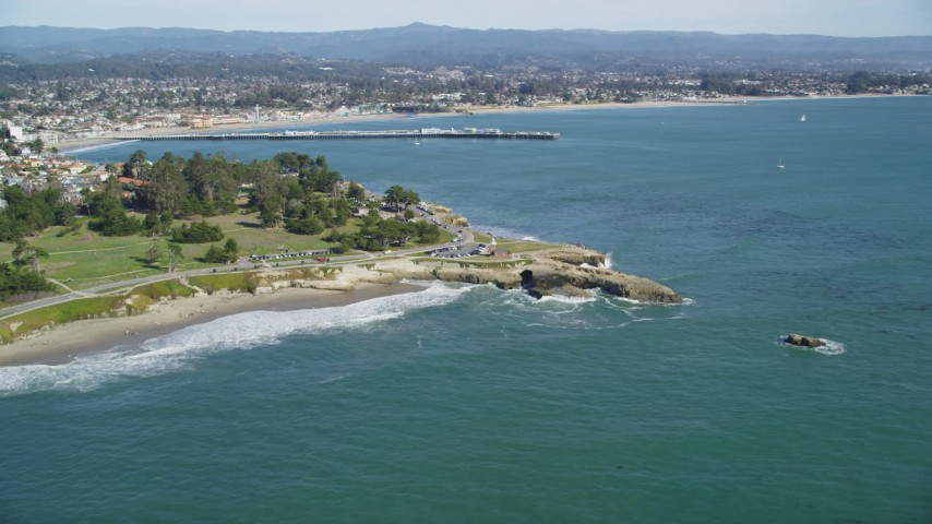 5K stock footage aerial video of tilt from kelp forests to reveal coastal neighborhoods and Santa Cruz Wharf, Santa Cruz, California Aerial Stock Footage | DFKSF15_127