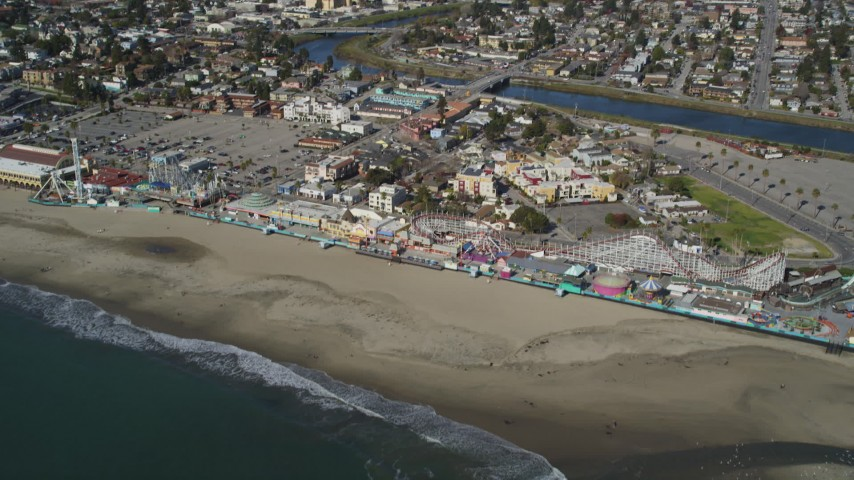 5K aerial video of tilting from the ocean to reveal roller coaster at Santa Cruz Beach Boardwalk, California Aerial Stock Footage | DFKSF15_131