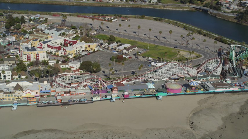 5K stock footage aerial video of a roller coaster at the Santa Cruz Beach Boardwalk, Santa Cruz, California Aerial Stock Footage | DFKSF15_132