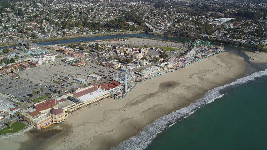 5K aerial video of passing the beach and rides at Santa Cruz Beach Boardwalk, Santa Cruz, California Aerial Stock Footage | DFKSF15_133
