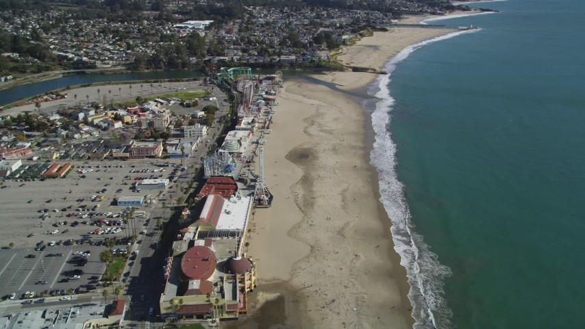 Flying by the beach and rides, Santa Cruz Beach Boardwalk, Santa Cruz, California Aerial Stock Footage | DFKSF15_134