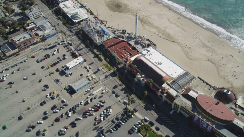 5K aerial video of flying by the beach and rides at Santa Cruz Beach Boardwalk, Santa Cruz, California Aerial Stock Footage | DFKSF15_135