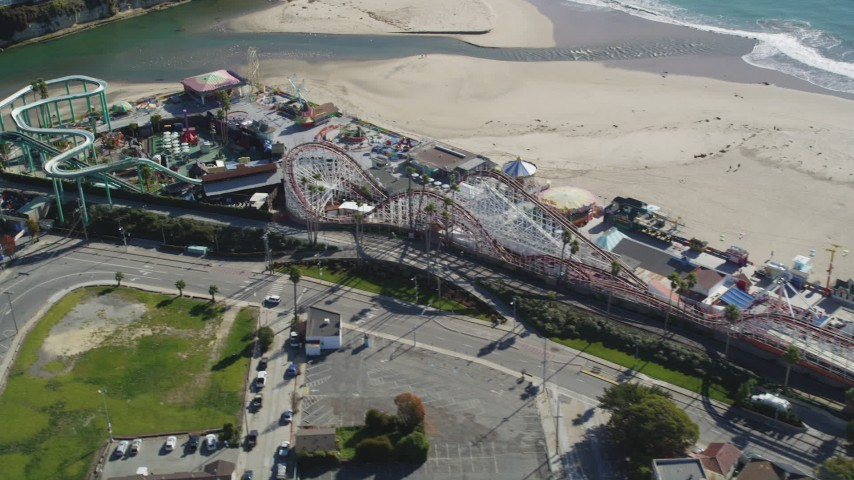 Flying by a roller coaster, Santa Cruz Beach Boardwalk, Santa Cruz, California Aerial Stock Footage | DFKSF15_136