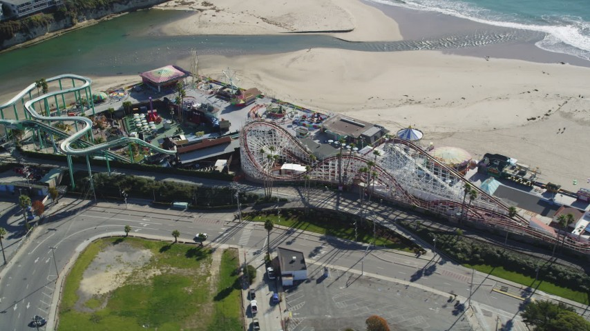5K aerial video of passing a roller coaster at Santa Cruz Beach Boardwalk, Santa Cruz, California Aerial Stock Footage | DFKSF15_136