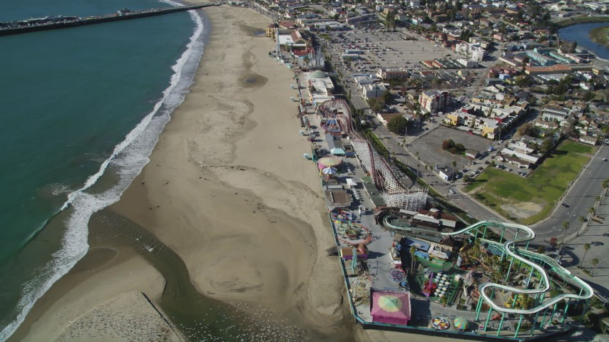 5K aerial video of orbiting the beach and rides at the Santa Cruz Beach Boardwalk, Santa Cruz, California Aerial Stock Footage DFKSF15_137