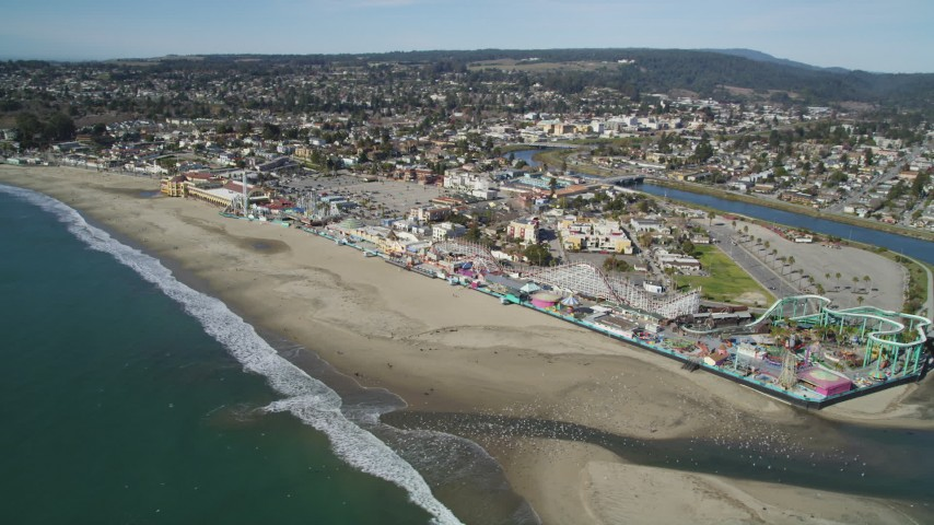 Flying away from Santa Cruz Beach Boardwalk, coast, Santa Cruz, California Aerial Stock Footage | DFKSF15_138