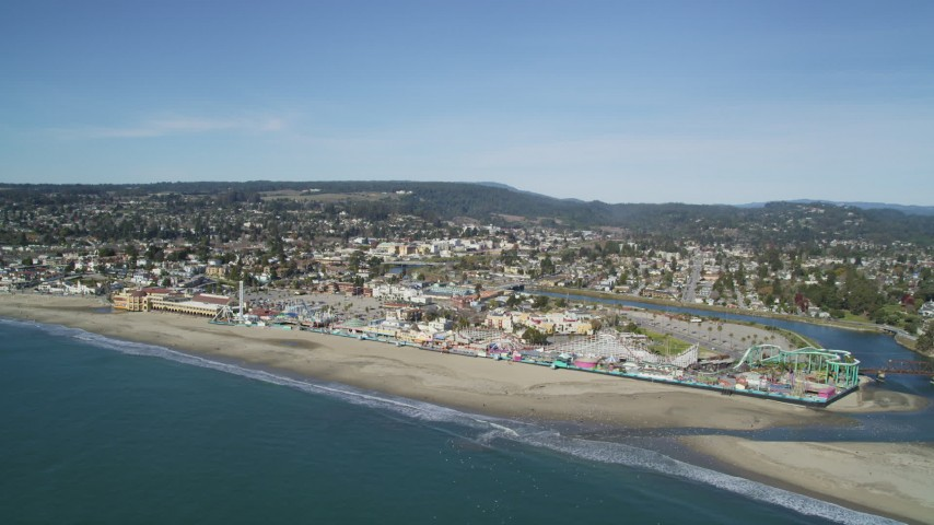 5K stock footage aerial video of flying away from Santa Cruz Beach Boardwalk and coast, Santa Cruz, California Aerial Stock Footage | DFKSF15_138