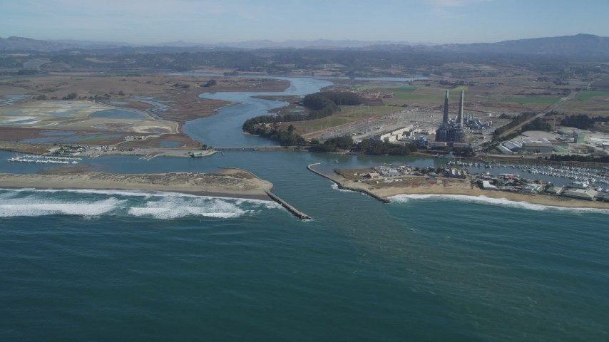 5K stock footage aerial video of a power plant with smoke stacks near a beach, Moss Landing, California Aerial Stock Footage | DFKSF15_147