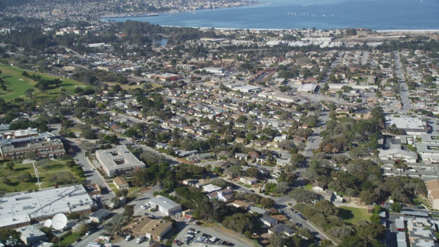5K aerial  video tilt from neighborhood to reveal Monterey Peninsula and Monterey Bay, Monterey, California Aerial Stock Footage | DFKSF15_156
