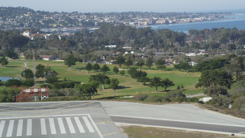 5K stock footage aerial video tilt from golf course to reveal the coastal community of Monterey, California Aerial Stock Footage | DFKSF15_157