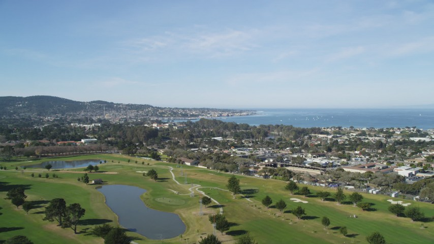 5K stock footage aerial video approach Monterey Peninsula while flying over a golf course, Monterey, California Aerial Stock Footage | DFKSF16_001