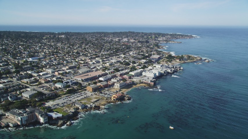 5K stock footage aerial video tilt to reveal coastal neighborhoods and Monterey Bay Aquarium, Monterey, California Aerial Stock Footage | DFKSF16_006