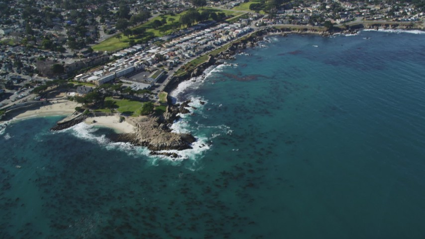 5K stock footage aerial video tilt from ocean kelp to reveal coastal residential neighborhoods, Monterey, California Aerial Stock Footage | DFKSF16_009