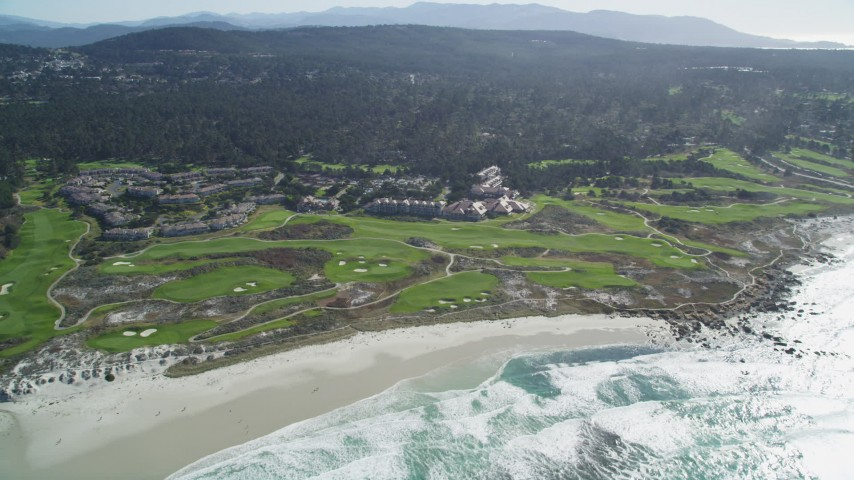5K stock footage aerial video of flying by a coastal resort and golf course, Pebble Beach, California Aerial Stock Footage | DFKSF16_015