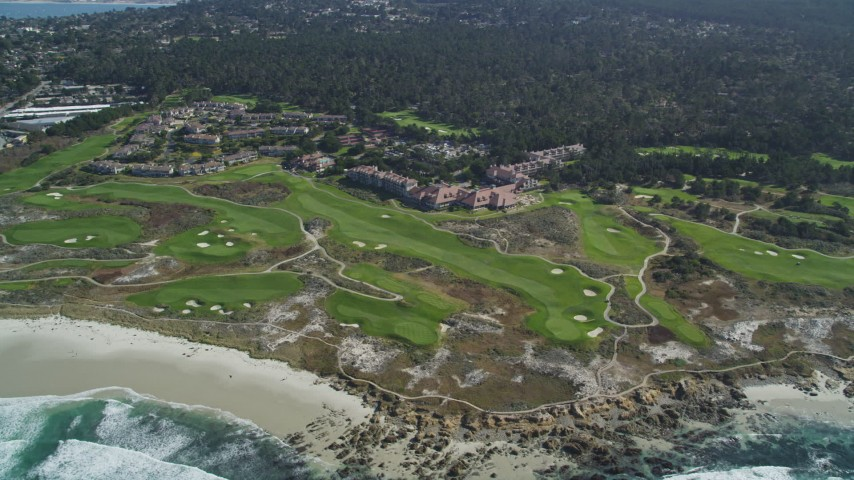 5K stock footage aerial video flyby a coastal hotel and resort with golf course in Pebble Beach, California Aerial Stock Footage | DFKSF16_016