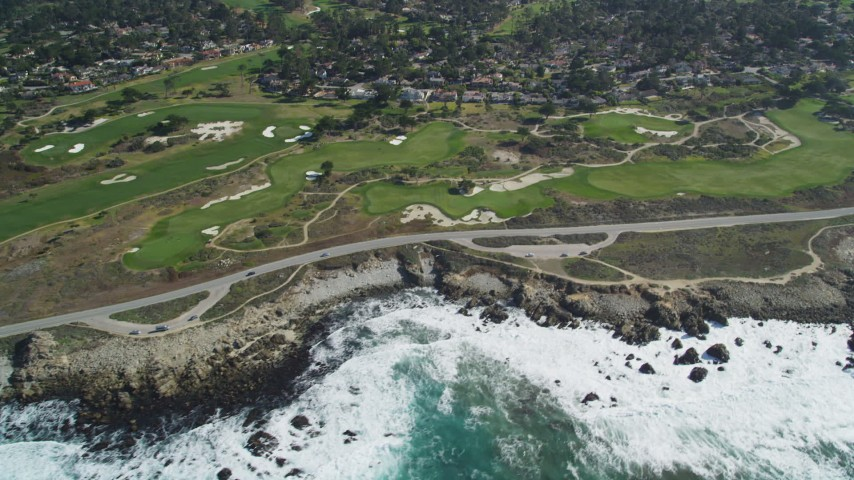 5K stock footage aerial video of 17 Mile Drive coastal road and golf course near homes in Pebble Beach, California Aerial Stock Footage | DFKSF16_017