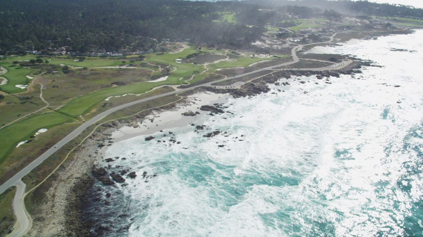 5K stock footage aerial video of a coastal road and golf course in Pebble Beach, California Aerial Stock Footage | DFKSF16_018