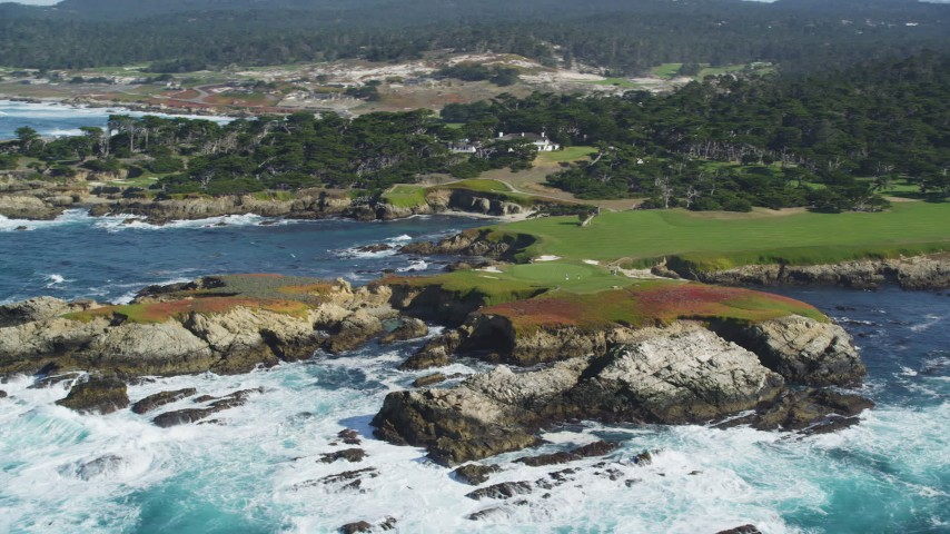 5K stock footage aerial video of flying by the coastline around Cypress Point Golf Course in Pebble Beach, California Aerial Stock Footage | DFKSF16_022