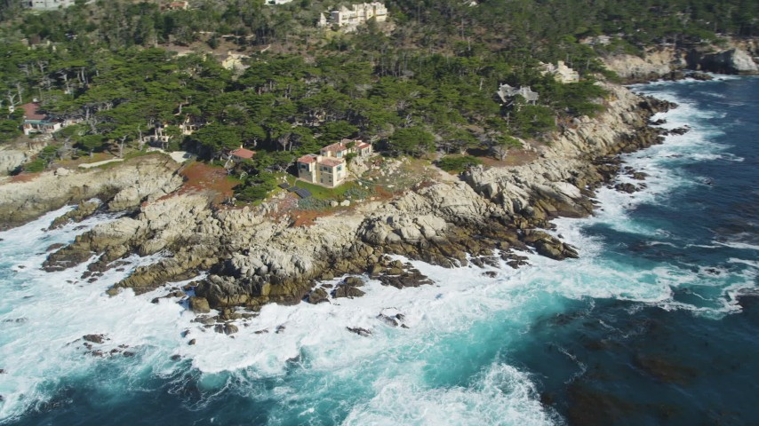 5K stock footage aerial video of tilting from the ocean to reveal coastal mansions, Pebble Beach, California Aerial Stock Footage | DFKSF16_023