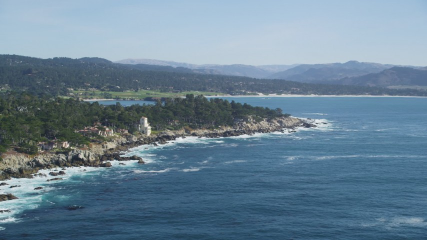 5K stock footage aerial video of flying by oceanfront mansions on the coast in Pebble Beach, California Aerial Stock Footage | DFKSF16_024