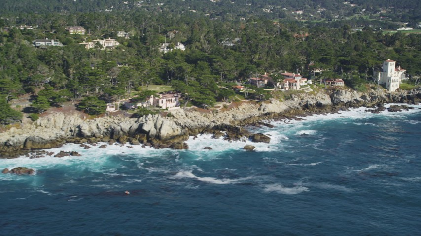 5K stock footage aerial video of passing by oceanfront mansions on the coast, Pebble Beach, California Aerial Stock Footage | DFKSF16_025