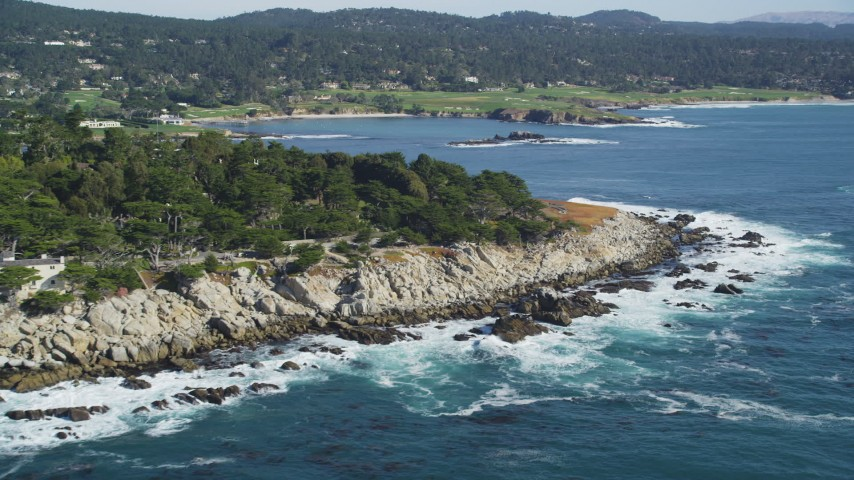 5K stock footage aerial video of flying by oceanfront homes and coastline, Pebble Beach, California Aerial Stock Footage | DFKSF16_026